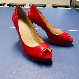 Red peep-toe pumps